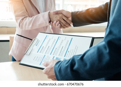 of successful business team shaking hands with eachother in the office, job interview concept.
