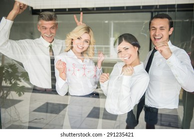 Successful business team standing in line at office.