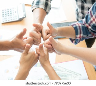 Successful business team wearing casual plaid shirt  with thumbs up,cheerful business group giving thumbs up,Group of multiracial business people thumbs up,Multiracial business team giving thumbs up,
