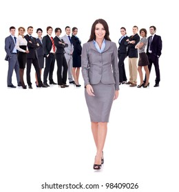 successful business team with a business woman walking forward leading it - be different concept - isolated over a white background