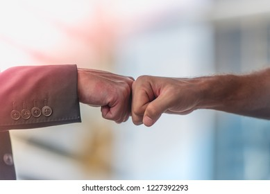 Successful business teamwork and volunteer, people fist Bump together.
