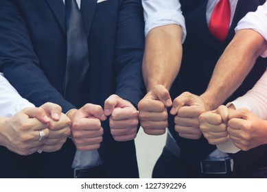 Successful business in teamwork and volunteer, people fist Bump together.