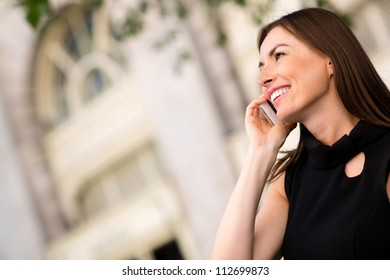 Successful business woman calling on her cell phone