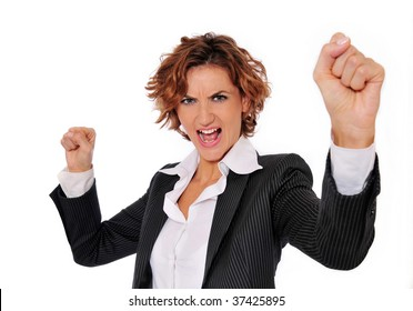 Successful business woman in charge and excited, with her arms up in the air and her fists clenched, ready to take on any obstacle.