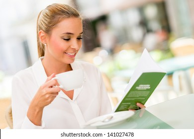 Successful business woman drinking a cup of coffee