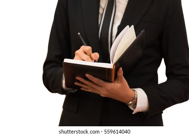 Successful business woman holding a note book and writing a business plan  to grow business up more