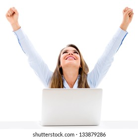 Successful business woman with laptop and arms up - isolated over a white background