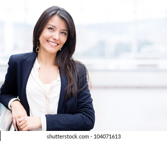 Successful business woman looking confident and smiling