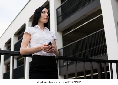 Successful business woman looks aside in ?ity