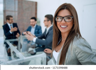 successful business woman sitting at a table in the meeting room