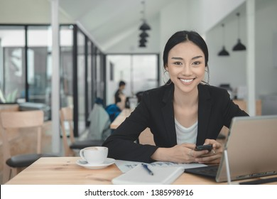 Successful business woman working on laptop computer.Typing laptop keyboard on working desk.Business Professional look enjoy working concept.