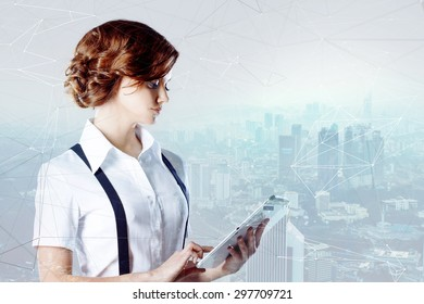 Successful business woman working on laptop, city   background
