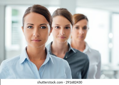 Successful business women entrepreneurs standing and smiling at camera, empowerment and determination concept