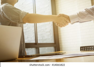 Successful business,Handshake,Man and woman holding hands closeup,selective focus,Vintage tone,copy space