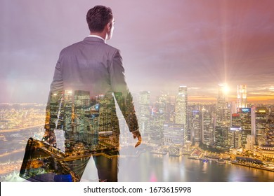 Successful businessman against cityscape in business concept