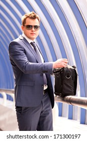 successful businessman with briefcase in office corridor