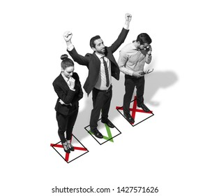 Successful businessman defeating his competitors and celebrating with raised fists, career and business challenge concept