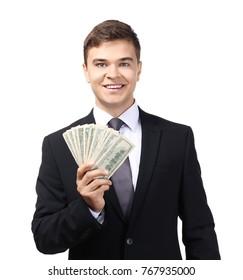 Successful businessman with dollar bills on white background