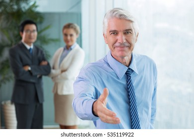 Successful businessman extending hand for greeting