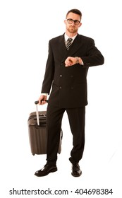 Successful businessman in formal suit and briefcase going on business trip isolated over white.