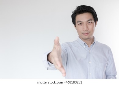 Successful businessman giving a hand on white background