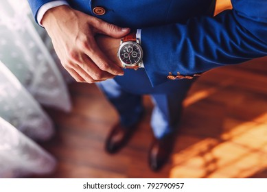 A successful businessman or groom wearing an expensive watch.jpg
