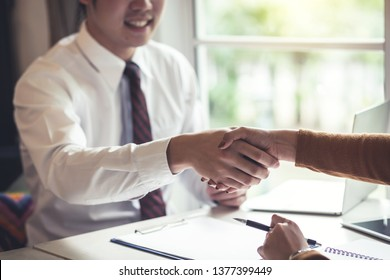 Successful businessman handshake at meeting. Congratulations and Confirmation in the agreement investment together.