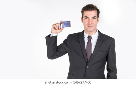 Successful Businessman handsome wearing a suit Tie executive holding credit card Convenient, easy to travel and spend.
