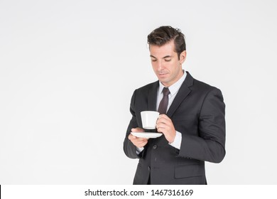 Successful Businessman handsome wearing a suit  and Tie Boss holding coffee cup drinking coffee in morning