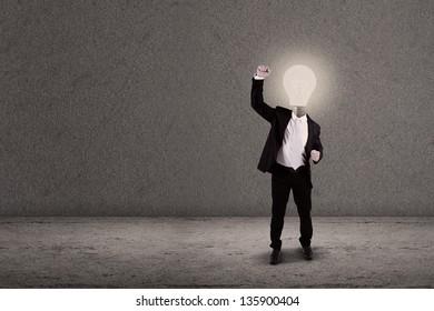Successful businessman with lightbulb head