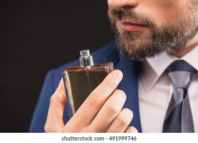 Successful businessman likes perfume scent