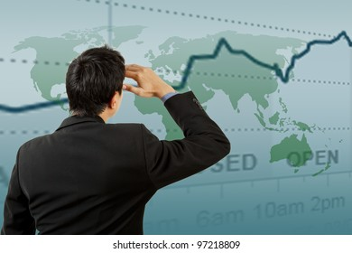 Successful businessman looking graph