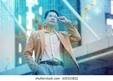 successful Businessman looking up on modern skyscraper while standing outdoors, young executive male director admires something on the distance during work break outside of company