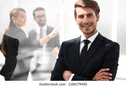 successful businessman on the background of the modern office