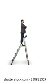 successful businessman on the stepladder looking forward and smiling. isolated on white background
