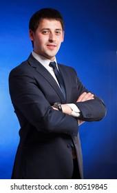 Successful businessman over blue background