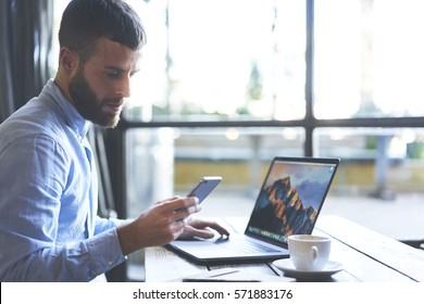 Successful businessman owner of company waiting for phone call from financial manager reporting about signing new beneficial contract while taking data base in laptop computer connected to wifi