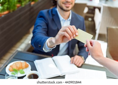 Successful businessman paying bill in cafe