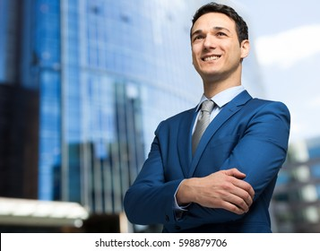 Successful businessman portrait outdoor in a modern city