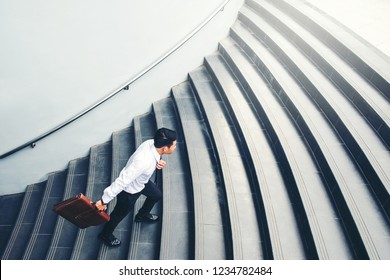 Successful businessman running fast upstairs Success concept