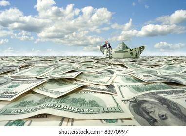 Successful businessman sailing on dollar boat in financial sea