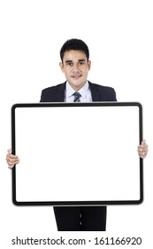 Successful businessman showing empty board isolated on white background