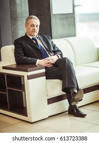 successful businessman sitting in chair modern office