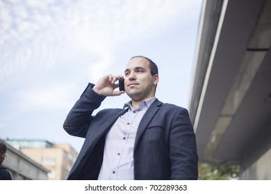 Successful businessman speaks by phone