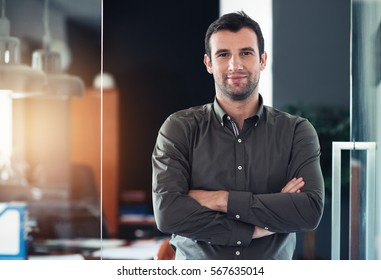 Successful businessman standing in his office