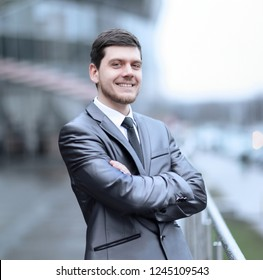 successful businessman standing on the balcony of the office