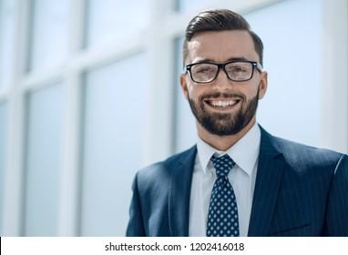 successful businessman standing on a light background.