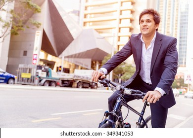 Successful businessman in suit with bicycle in city