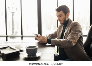 Successful businessman using digital tablet in a cafe