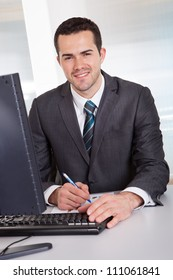 Successful businessman working at desk at the office